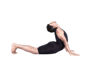 Man in a sun salutation pose